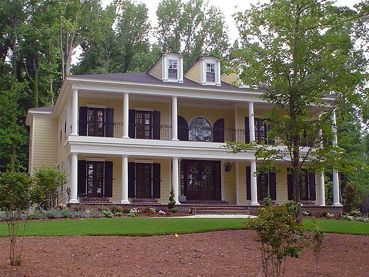 Planos de mansión de dos niveles, cuatro dormitorios, cuatro baños, un garaje